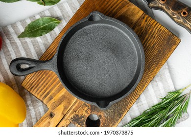 Empty frying cast iron pan background, kitchenware cooking concept set, on white stone surface, top view flat lay, with copy space for text