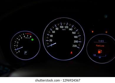 Empty fuel gauge warning light in car dashboard.  Red warning  light door.