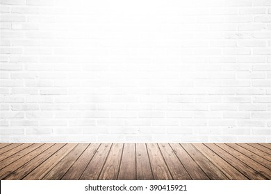 empty gallery interior room with old white brick wall texture and brown grunge wooden plank floor pattern, blank space background or backdrop for design element and display product in vintage style
