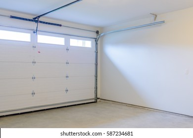 an empty garage with door and windows - Garage Door With Door