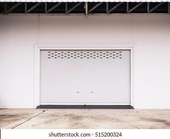 Empty garage with Shutter door or roller door and concrete floor ,  industrial building,Empty underground