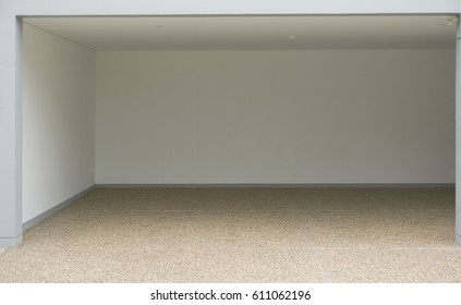 The empty garage with white wall and sand wash floor