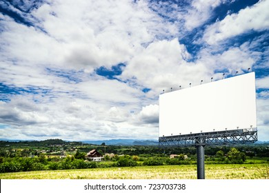 empty giant billboard in countryside and blue sky cloudscape - can use to display or montage on product