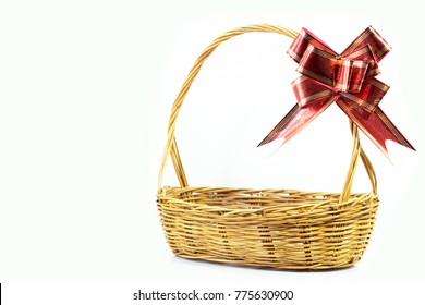 Empty gift basket with red-gold ribbon bow for Christmas and new year gift isolated