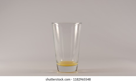 Empty Glass after an orange juice on a white background