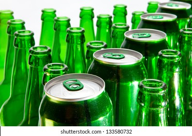 Empty glass beer bottles and cans