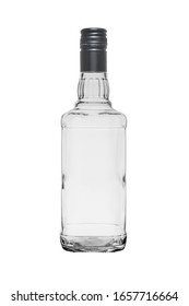 Empty glass bottle of square shape for whiskey, closed with a metal stopper. Isolated on a white background