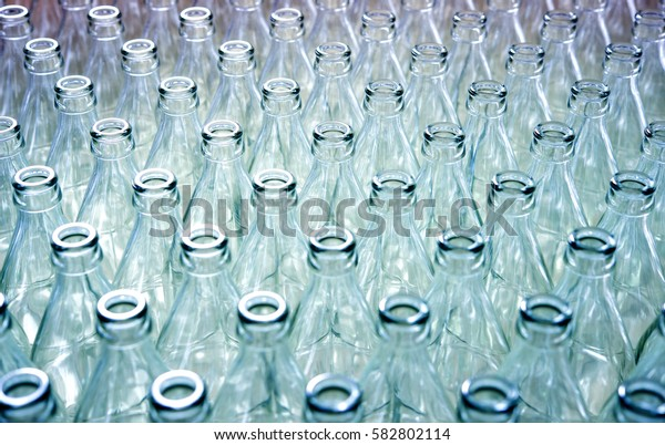 Empty glass bottles in factory to fill with drink