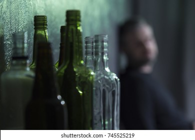 Empty glass bottles of wine and beer. Alcohol problem concept