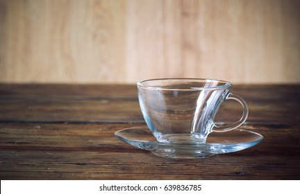 empty glass cup and wooden table