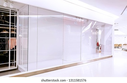 An empty glass display of the cloths shop without people