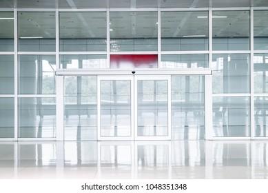 empty glass door in office building with copy space