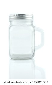 Empty glass jar with aluminum lid isolated on white