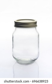 Empty Glass Jar With Chrome Metal Lid Shot In Studio On White Background