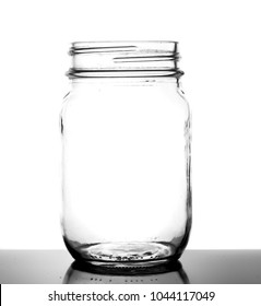 Empty Glass Jar Detail Isolated on White Background