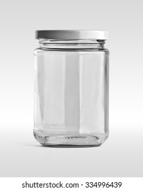 Empty glass jar and white cap in front view isolated on white background. Clipping path.