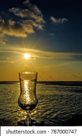 Empty glass is on a beach table (Maldives, The Indian Ocean)