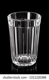 Empty glass on black background with reflection and highlights