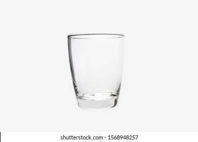 Empty glass on white background . It clear and purity , They can contain water and have reflection sometime.