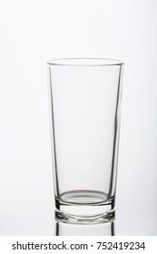 Empty glass on white background