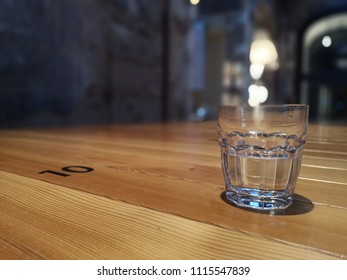 empty glass on a wooden table