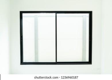 empty glass window and door in home with sunlight