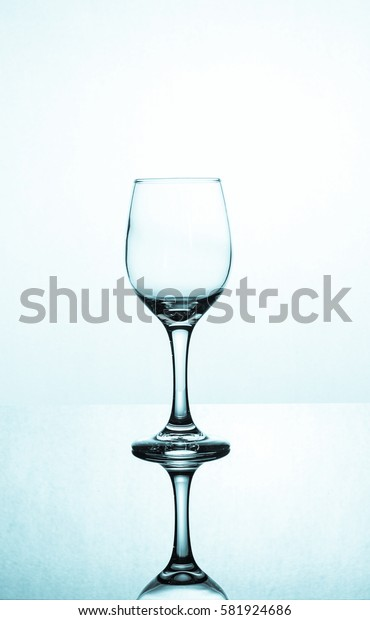 Empty glass of wine isolated on white background