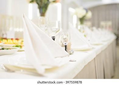 empty glasses behind white napkin
