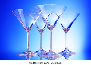 empty glasses of martini on the light blue background