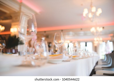empty glasses on table at banquet hall