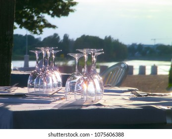 Empty glasses on a table at luxury French restaurant outdoor.
