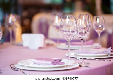 empty glasses and plates with forks in restaurant