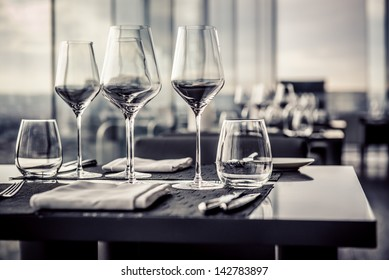 Empty glasses in restaurant, black and white photo