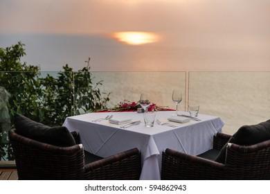 Empty glasses set in restaurant Dinner table outdoors at sunset