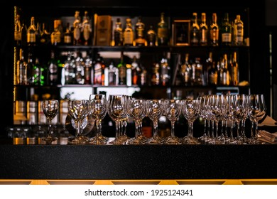 empty empty glasses for wine on a bar on a dark background. serving items. drinkware