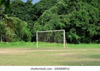 Empty goal post in a soccer field