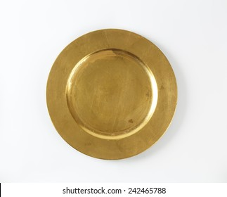empty gold plate on white background