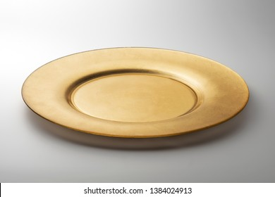 Empty Golden round flat plate isolated on white background