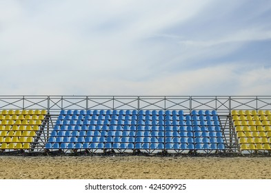 empty grandstand against the backdrop of a cloudy sky