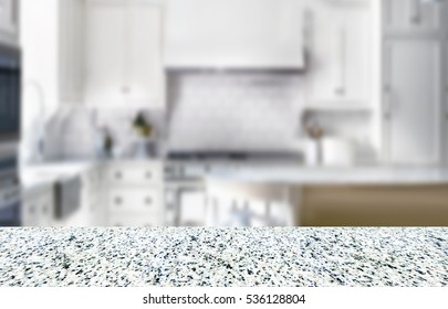 empty granite surface for the product with the light blurred kitchen on background