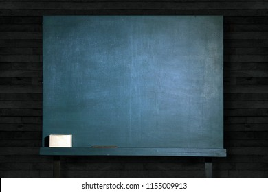 empty green blackboard on wooden wall in classroom for education background.