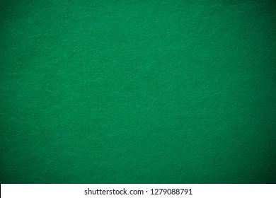 Empty green casino poker table cloth with spotlight.