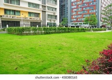 Empty green field around by business zone in Guangzhou,China.
