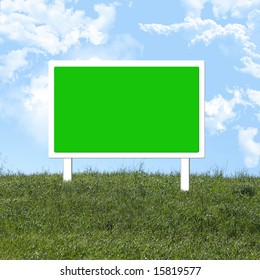 Empty green road sign on a grassy hill with space for copy