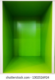 Empty green room space, Empty box interior for design and decoration - abstract background. square box with blank inner space. Empty copy space perspective view. Photobox inside.