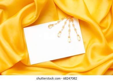 empty greeting card on yellow satin background