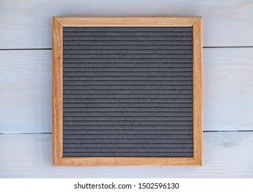 empty grey felt letterboard on natural wood background. procurement for design