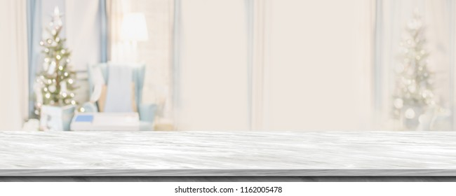 Empty grey marble table top with abstract warm living room decor with christmas tree blur background with bokeh light,Holiday backdrop,Mock up banner for display of advertise product ,luxury house