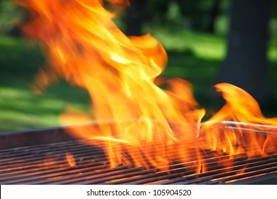 empty grill with flames and space for own things