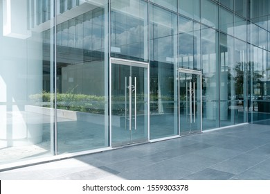 Empty ground in front of modern glass wall facade buildings . - Shutterstock ID 1559303378